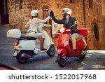 Young Italian Couple On Vespa...