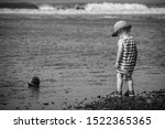Young Boy Standing At The Sea...