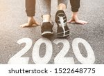 Small photo of Woman in sports uniform running around. Healthy way of life, an infused figure. sneakers close-up, finish 2019 Start to new year 2020, plans, goals, objectives