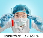 Happy laboratory technician with results of experiments - stock photo