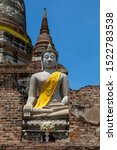 Small photo of Ayutthaya, Thailand - 12 July 2017: Buddha statues at Wat Yai Chai Mongkhon. Built by King U-thong in 1357 A.D. to accommodate the monks that were ordained by Phra Wanratana Mahathera Burean.