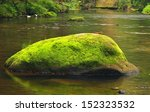 Mossy Boulder In The River...