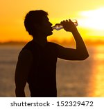 man drinking bottle of water on ...   Shutterstock . vector #152329472
