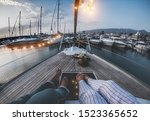 Legs view of senior couple having holidays on sail vintage boat - 60's trendy people enjoying a romantic vacation  - Travel, luxury, joyful elderly lifestyle and love concept - Focus on feet - stock photo