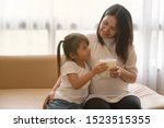 little asian girl and her...   Shutterstock . vector #1523515355