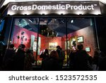 Small photo of London, UK - October 2, 2019: Crowds looking at the art on display by Banksy at the street artist's Gross Domestic Product temporary showroom in Croydon, South London.