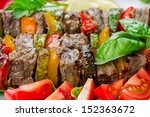 grilled meat on skewers with... | Shutterstock . vector #152363672