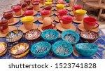 Rows Of Souvenir Ceramic Ornat...
