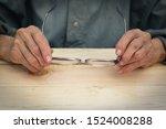 hands of an elderly man hold... | Shutterstock . vector #1524008288