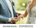 Man Wearing Wedding Ring On...