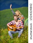Love time. western camping. hiking. couple in love spend free time together. friendship. campfire songs. men play guitar for girl. happy friends with guitar. country music. romantic date. - stock photo