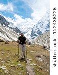 hiker is climbing mountain in... | Shutterstock . vector #152438228