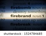 Small photo of firebrand word in a dictionary. firebrand concept, definition.