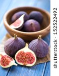 Group Of Figs In A Bowl And On...