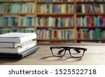 Eyeglasses With Stacked Books...