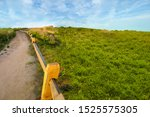 dirt trail with wood fence with ... | Shutterstock . vector #1525575305
