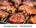 Closeup of steak on grill fire-toasted - stock photo