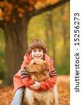 Boy Hugging Dog In The Fall