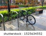 A Black Bike Parked By A Modern ...