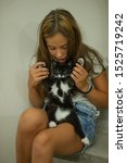 Stock photo pretty young caucasian girl with cute kitten teenager girl with a wary kitten a child and a cat 1525719242