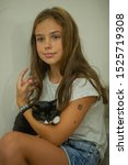 Stock photo pretty young caucasian girl with cute kitten teenager girl with a wary kitten a child and a cat 1525719308