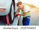 Handsome middle age man working in towing service on the road. Roadside assistance concept. - stock photo