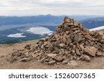 Pyramid of stones and mountain lakes view. Summit ridge of Mount Elbert, Colorado, USA.