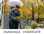 Couple In Grief On A Cemetery...