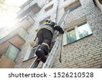 Fireman Climbs Stairs Up In...