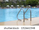 ladder of a swimming pool. | Shutterstock . vector #152661548