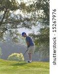 male golfer lining up.... | Shutterstock . vector #15267976