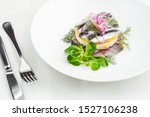 Stock photo appetizer food salted herring butter and red onion on white plate selective focus horizontal 1527106238