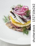 Stock photo appetizer food salted herring butter and red onion on white plate selective focus vertical view 1527106262