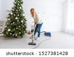 Young Woman Cleaning With...
