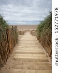A Wooden Planked Walkway To A...