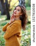 pretty woman wearing sweater... | Shutterstock . vector #1527810038