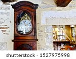 An Ancient Clock Fixed Into A...