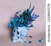 Vase Skull With Dry Flowers....
