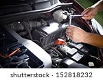 auto mechanic working in garage.... | Shutterstock . vector #152818232