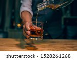 Barman pouring whiskey whiskey glass beautiful night