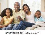 family sitting in living room...   Shutterstock . vector #15286174