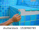 Tiled Pool. The Man Hand While...