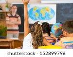 schoolgirl rising her hand at... | Shutterstock . vector #152899796