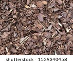 Small photo of Shredded pine bark mulch for covering the soil in garden to avoid noxious plants.
