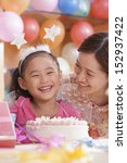 birthday girl and her mother | Shutterstock . vector #152937422