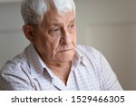 Small photo of Face of senior caucasian hoary man looking away deep in sad thoughts feels lonely close up portrait, recollect memories and life moments, depressed grandfather alone indoors, yearning for wife concept