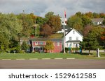 Small photo of PARRY SOUND, ONTARIO, CANADA - SEPT 25, 2006: Huckleberrys Home and Cottage, a little shshopping, landmark, outside, retail shop nestled on the shore of Georgian Bay in Parry Sound.