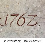 The year 1762 carved in stone and painted in red – a detail of an inscription produced that year