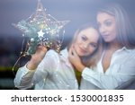 young lesbian couple holding... | Shutterstock . vector #1530001835