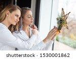 young girlfriends put christmas ... | Shutterstock . vector #1530001862